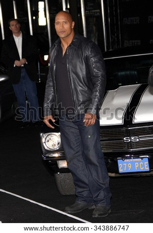 "HOLLYWOOD, CALIFORNIA - November 22, 2010. Dwayne Johnson at the Los Angeles premiere of ""Faster"" held at the Grauman's Chinese Theater, Los Angeles."