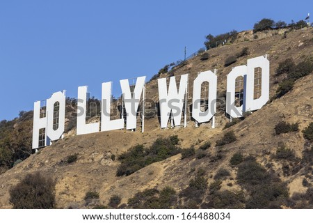 HOLLYWOOD, CALIFORNIA - October,31:  Hugh Hefner and others donate money to the Hollywood sign trust to protect land behind the sign from development, on October 31, 2013 in Los Angeles, California. - stock photo