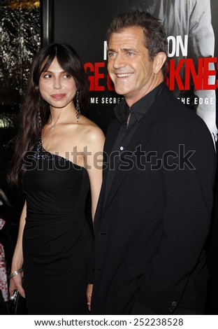 """HOLLYWOOD, CALIFORNIA - Tuesday January 26, 2010. Mel Gibson and Oksana Grigorieva at the Los Angeles premiere of """"Edge of Darkness"""" held at the Grauman's Chinese Theater, Hollywood. - stock photo"""