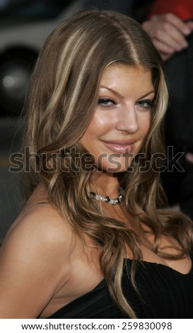 "HOLLYWOOD, CALIFORNIA. Wednesday May 10, 2006. Stacy Ferguson attends the Los Angeles Premiere of ""Poseidon"" held at the Grauman's Chinese Theater in Hollywood, California United States."