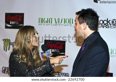 HOLLYWOOD - DECEMBER 31: Actor Seth MacFarlane is interviewed by Hollyscoop at Gridlock New Year's Eve at Paramount Studios on December 31, 2008 in Hollywood, California. - stock photo
