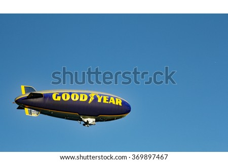 Hollywood, FL, USA - December 14, 2014: One Goodyear blimp flying in the sky in Hollywood, Florida. An airship in the sky with the words Good Year written on its side.