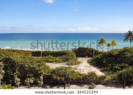 Hollywood, FL, USA - December 7, 2014: Sunny view from a watch tower over looking Hollywood North Beach Park. High up view of a protected natural area and Hollywood beach.