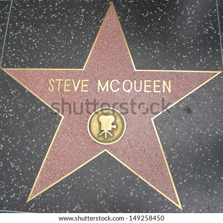 HOLLYWOOD - JULY 11: Steve McQueen's star on Hollywood Walk of Fame, as seen on July 11, 2013 in Hollywood in California. This star is located on Hollywood Blvd. and is one of 2400 celebrity stars. - stock photo