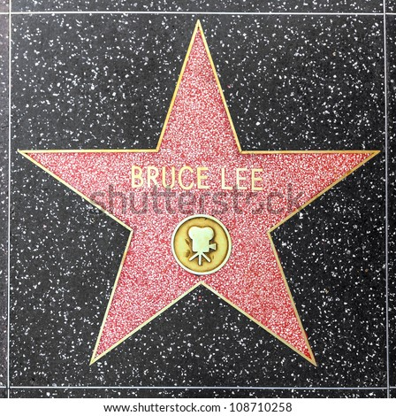 HOLLYWOOD - JUNE 26: Bruce Lees star on Hollywood Walk of Fame on June 26, 2012 in Hollywood, California. This star is located on Hollywood Blvd. and is one of 2400 celebrity stars. - stock photo