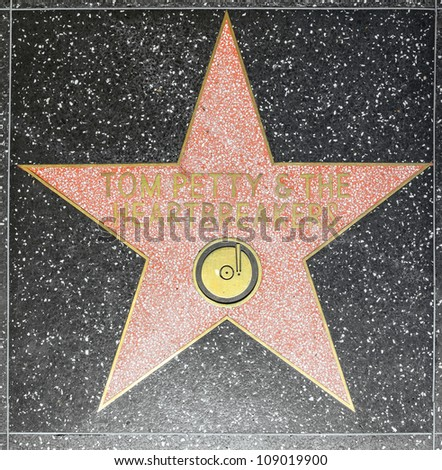 HOLLYWOOD - JUNE 26: Tom Petty & the Heartbreakers star on Hollywood Walk of Fame on June 26, 2012 in Hollywood, California. This star is located on Hollywood Blvd. and is one of 2400 celebrity stars.