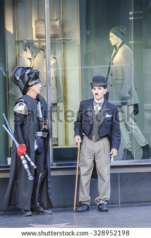 Hollywood, Los Angeles, California, USA - November 6, 2013: People in costumes of Charlie Chaplin and Lord Dred from Star Wars on Hollywood Boulevard. - stock photo