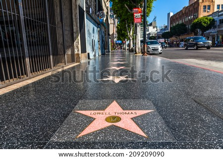 HOLLYWOOD, LOS ANGELES - OCT 20: The World famous Hollywood Walk of Fame seen on October 20, 2013 in Hollywood, California. There are over 2400 celebrity stars on Hollywood Blvd. - stock photo