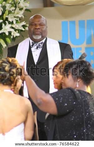 "HOLLYWOOD - MAY 4: Bishop T.D. Jakes performs a wedding ceremony at the premiere of the movie ""Jumping The Broom"" at the Cinerama Dome on May 4, 2011 Hollywood, CA - stock photo"