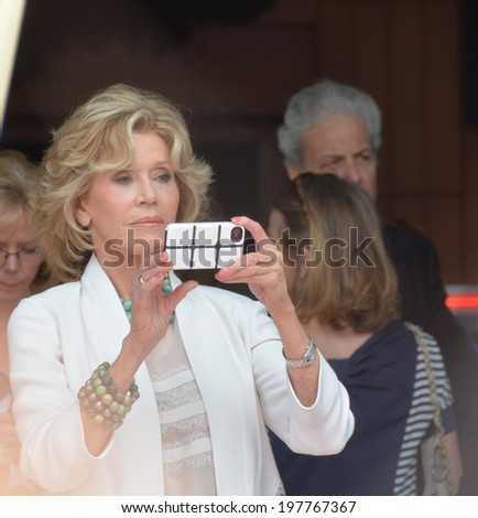 HOLLYWOOD - MAY 5: Jane Fonda is taking photo of crowd while Sally Field's star celebration on 5 May in 2014 at the Walk of Fame in Hollywood