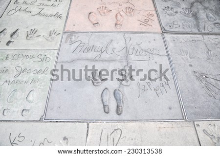 HOLLYWOOD - MAY 12: Maryl Streep's handprints in Hollywood Boulevard on May 12,2012 in Hollywood. There are nearly 200 celebrity handprints in the concrete of Chinese Theatre's forecourt. - stock photo
