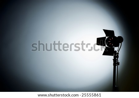 Hollywood movie light with barn doors and shadows - stock photo