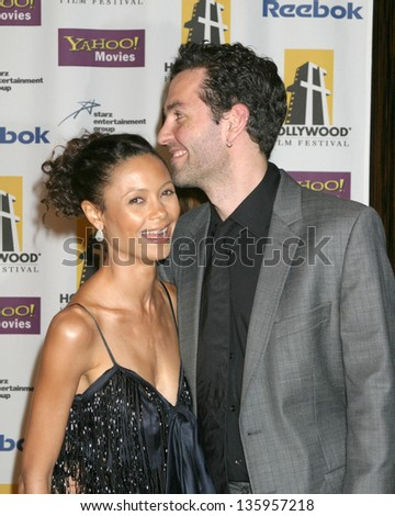 HOLLYWOOD - OCTOBER 24: Thandie Newton and husband participate at Hollywood Film Festival Gala in Beverly Hilton Hotel October 24, 2005 in Los Angeles, CA. - stock photo