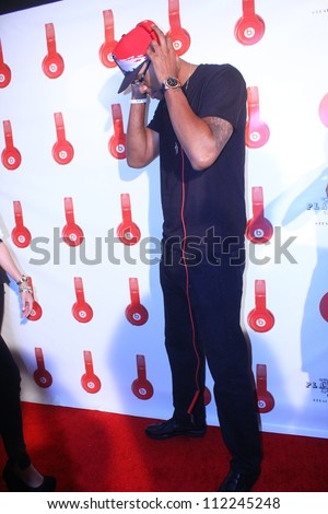 HOLLYWOOD - SEPTEMBER 6, 2012: LA Clippers' Trey Tompkins walks the red carpet for Beats by Dr Dre & Lil Wayne VMA after party the Playhouse Nightclub September 6, 2012 Hollywood, CA. - stock photo