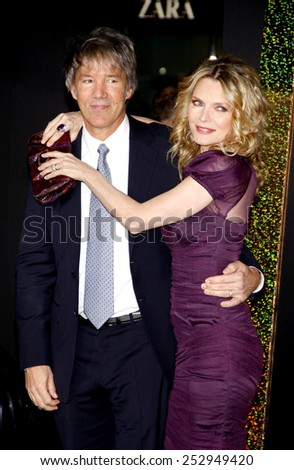 "HOLLYWOOD, USA - DECEMBER 5: David E. Kelley and Michelle Pfeiffer at the Los Angeles Premiere of ""New Year's Eve"" held at the Grauman's Chinese Theatre in Los Angeles, USA on December 5, 2011. - stock photo"