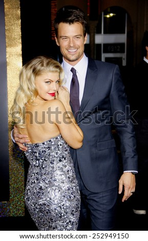 "HOLLYWOOD, USA - DECEMBER 5: Stacey 'Fergie"" Ferguson and Josh Duhamel at the Los Angeles Premiere of ""New Year's Eve"" held at the Grauman's Chinese Theatre in Los Angeles, USA on December 5, 2011. - stock photo"