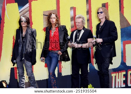 """HOLLYWOOD, USA - MARCH 28: Steven Tyler, Joey Kramer, Joe Perry and Tom Hamilton at the Aerosmith """"The Global Warming"""" Tour Press Conference held at the Grove in Los Angeles, USA on March 28, 2012. - stock photo"""