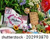 HOLMBY HILLS/CALIFORNIA - JUNE 28, 2009: Fans create memorial with candles, flowers and cards honoring singer Michael Jackson upon his death in Los Angeles. June 28, 2009 Holmby Hills, California USA - stock photo