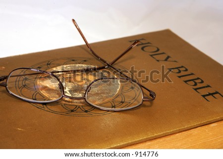 Holy Bible and glasses - stock photo