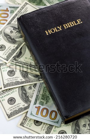 Holy Bible and money. Hundred dollars - stock photo