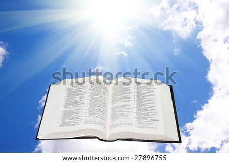 Holy bible in the sky illuminated by a sunlight - stock photo