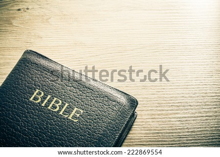 Holy Bible on a wooden table. Background concept with large copy space available. / Bible background