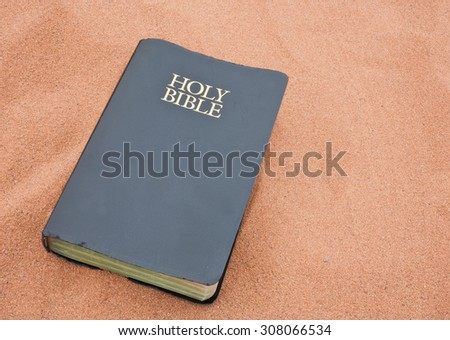 Holy Bible on sand - stock photo