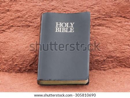 Holy Bible on sandstone. - stock photo