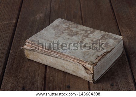 Holy Bible on the old wooden table - stock photo