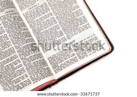 holy bible open to the book of  obadiah, against a white background