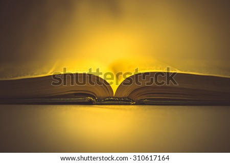 holy book on a yellow background