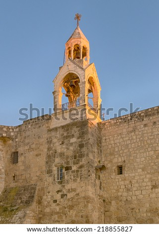 Holy Church Of The Nativity bell tower glows in the late afternoon sun, Bethlehem, Israel.  The church marks the spot where Jesus was born (Luke 2:7).