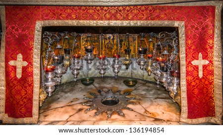 Holy Church Of The Nativity, Bethlehem, Israel - A silver star marks the site of the birth of Jesus (Luke 2:7) in a grotto underneath Bethlehem's Church of the Nativity. - stock photo