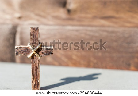 Holy cross in a sunny day and beautiful shadow of the cross - stock photo