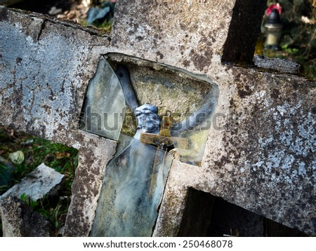 Holy Cross of the Lord Jesus on an abandoned graveyard - stock photo