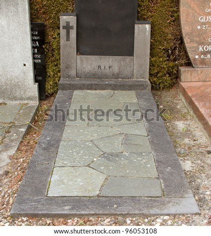 Holy Cross on an old marble grave in Holland - stock photo