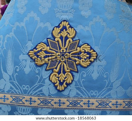 Holy Cross on slavic orthodox priest's blue mantle - stock photo