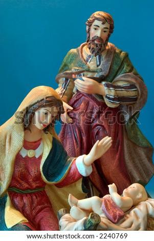 Holy Family - Joseph and Mary admire the baby Jesus. - stock photo