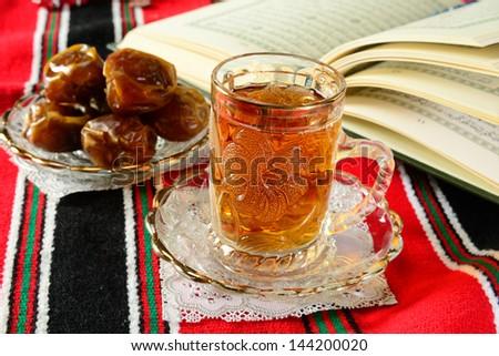 Holy Koran and traditional islamic food during ramadan. - stock photo