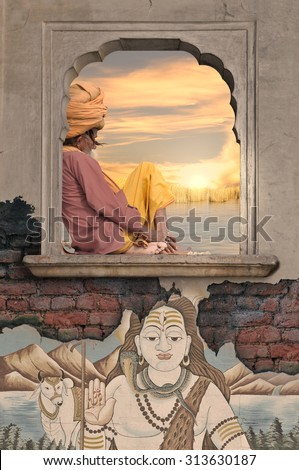 Holy man meditating on the window near Ganges.