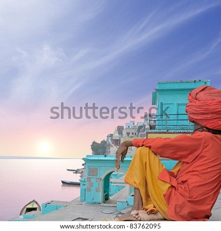 Holy man near Ganges in the morning. - stock photo