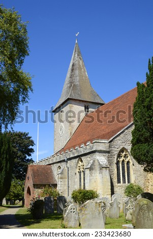 Holy Trinity Church at Bosham in West Sussex. England. With churchyard. - stock photo