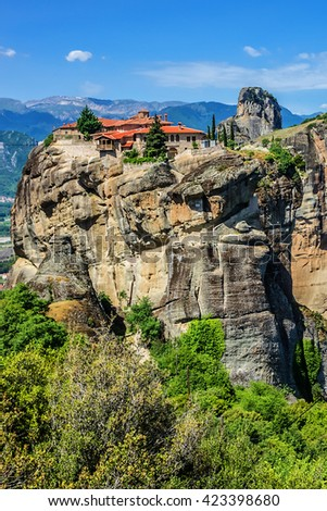 Holy Trinity Monastery (Agia Trias) - Eastern Orthodox monastery at the complex of Meteora monasteries. Peneas Valley, Greece. It is situated at the top of a rocky precipice over 400 meters high. - stock photo