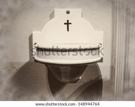 Holy water stoup aspersorium basin vessel bowl - stock photo
