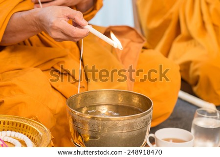 Holy water, the monks and religious rituals in thai ceremony. - stock photo