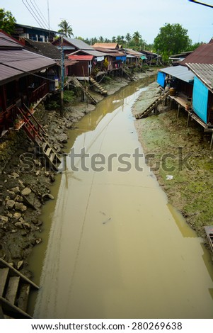 home and canal in Thailand - stock photo
