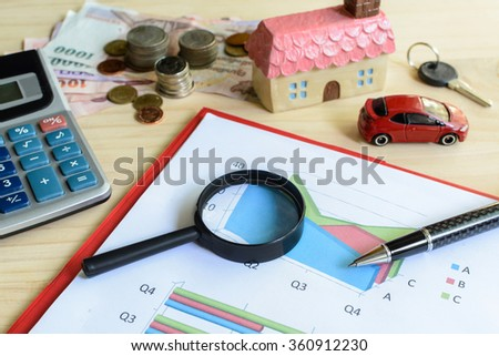 Home and car finance concept, residential house, expenses calculated - stock photo