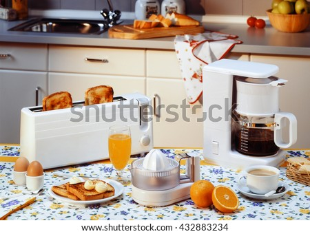 home appliances to prepare breakfast in the kitchen - stock photo