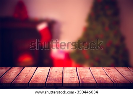 Home at christmas time against wooden table - stock photo