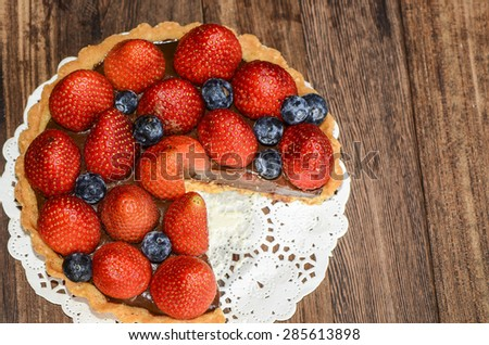 Home baked chocolate tart with strawberry and blueberry toppings with quality controlled ingredients / Chocolate tart / Best serve and eaten chilled - stock photo